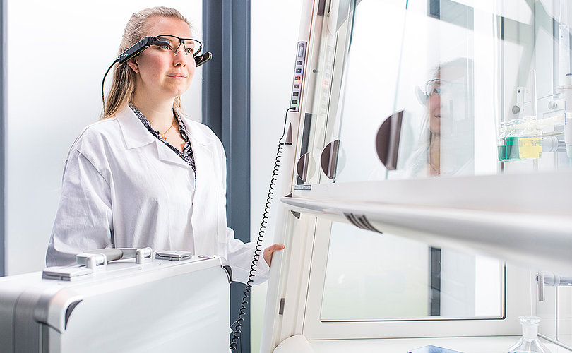 Woman in front of a fume hood